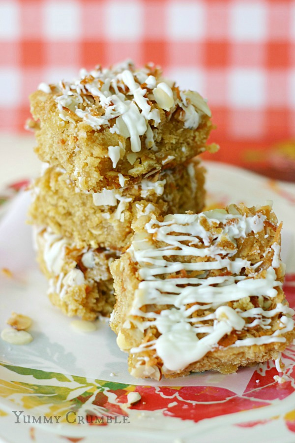 White Chocolate Pineapple Coconut Cookie Bars Drizzled with White chocolate www.yummycrumble.com
